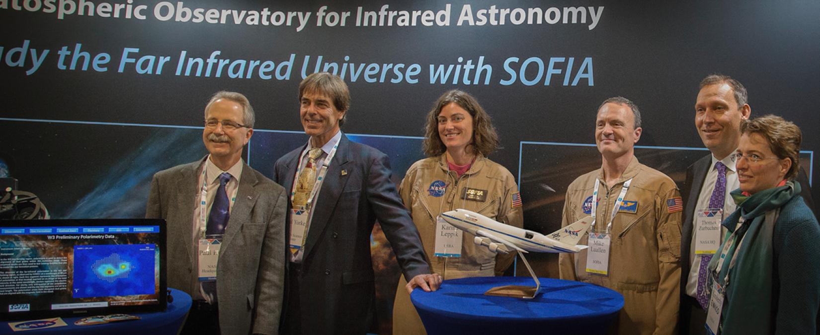 NASA and SOFIA staff at the SOFIA exhibit