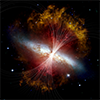 Magnetic fields in M82 are shown as lines over a visible light and infrared composite image