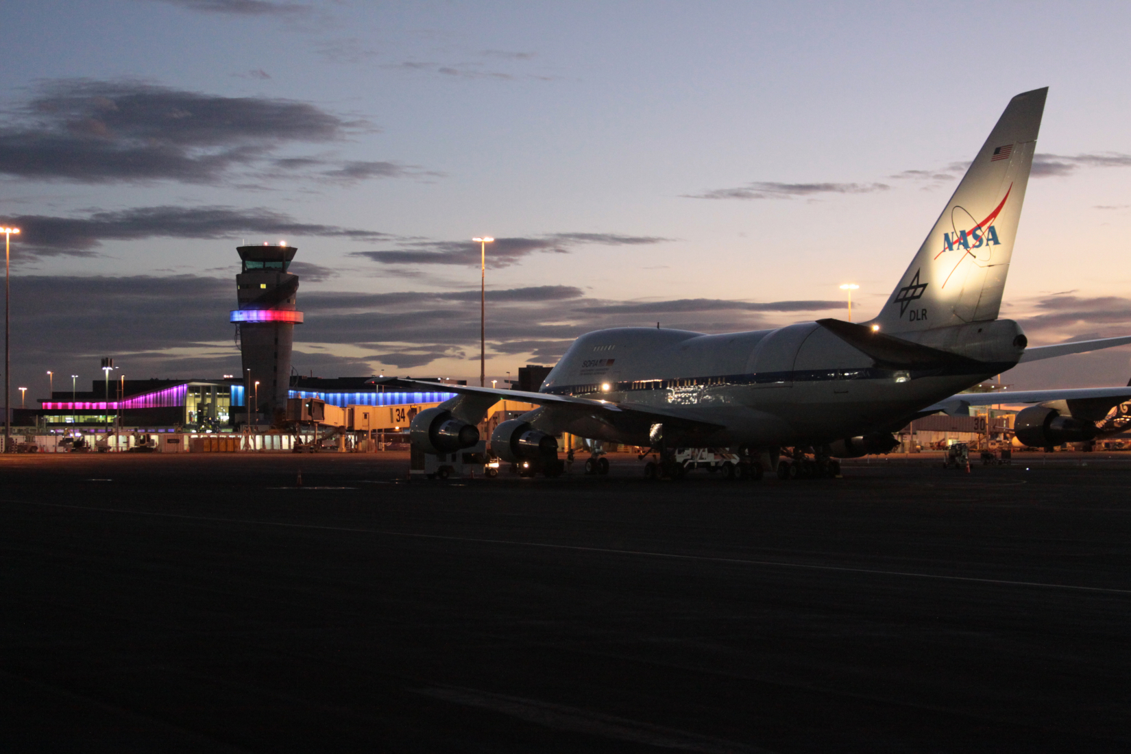 SOFIA on the National Science Foundation Antarctic Program Facility's ramp facing the Christchurch International Airport terminal and tower.