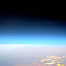 Noctilucent clouds forming in the mesosphere seen from International Space Station